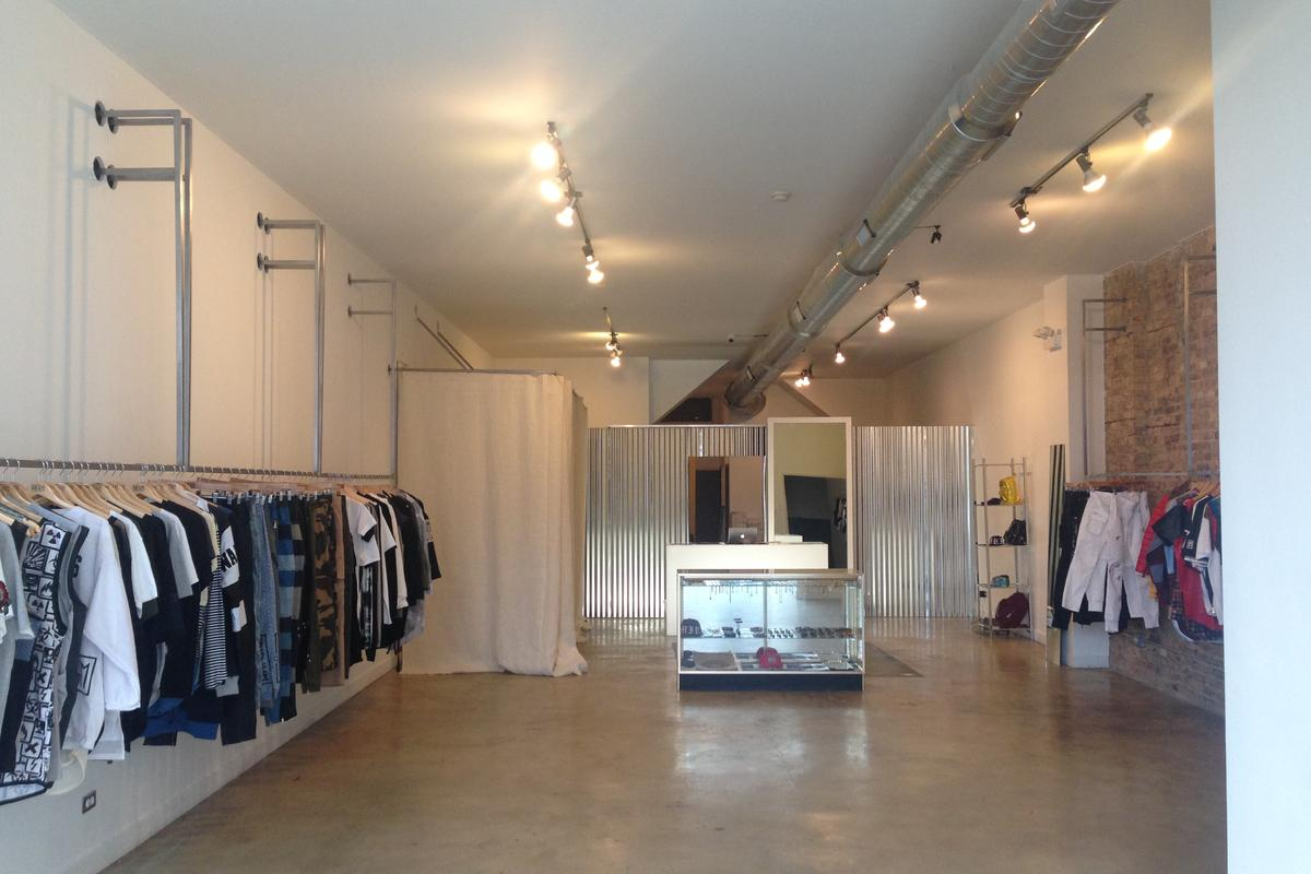 Storefront listing Iridium Clothing in West Town, Chicago, United States.